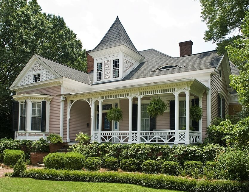 This home is a combination of gingerbread sawn details and sunburst balusters along the bottom of the porch railing. The curb appeal is undeniable and fits perfectly with the architecture