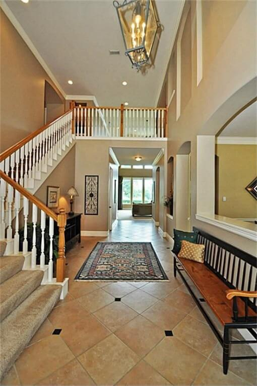 This is a very typical design in contemporary homes, combining bright white spindles with a rich oak railing and support posts.