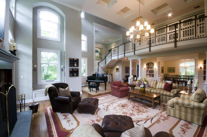 Here is a very high coffered ceiling with small panels and thick beams between. This coffered ceiling is simple, without much ornamentation, which works well with a wide open, clean and natural lit living room.