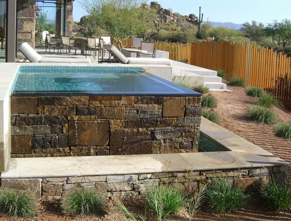 An infinity edge is a great way to make any body of water look sleek and modern. This is an example of an infinity edge that has an up-to-date appeal.