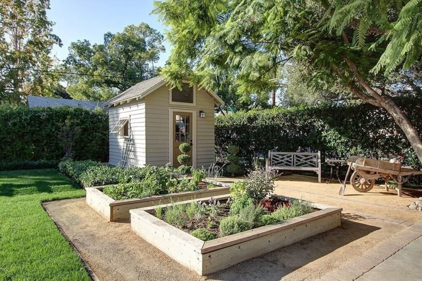There are two lovely neutral toned wooden raised garden bed in this wonderful garden area. These styles of raised garden bed are perfect for any back yard or personal garden area. It helps your garden contained, organized and looking good