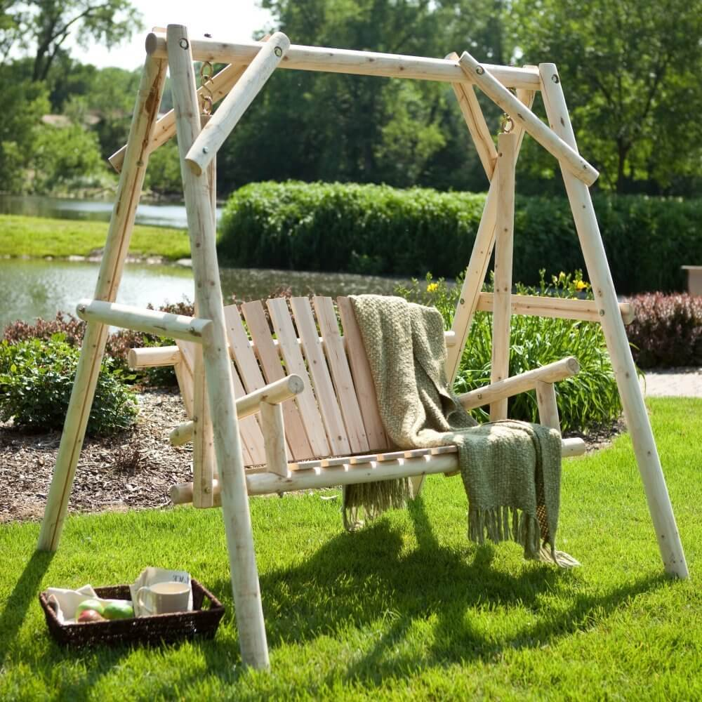 This swing is a rustic natural log design that would be simple to coat in any finish you would like. You could make the bench match any tone or design. This swing is also suspended from long wooden arms that are attached by small chains near the top. This limits the sway, and gives a more even and predictable forward swing.