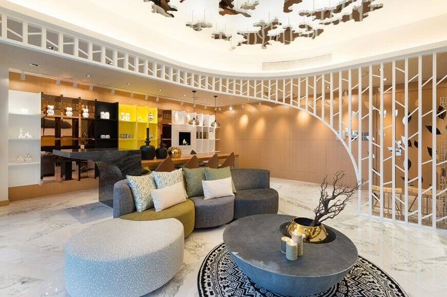 Here is an interesting ceiling with hanging elements. Hanging things from a ceiling like this can be a fun and interesting way to design your space and show a bit of your personality in your space.