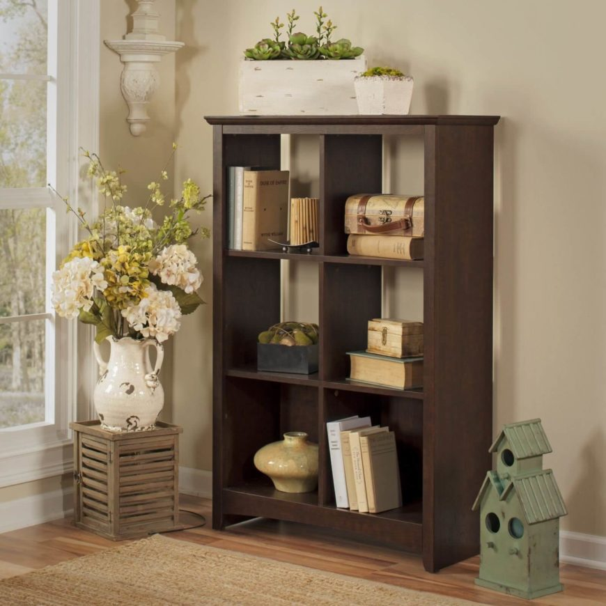 Here is basic bookshelf, which is always good for simple and easy storage solutions. These kinds of bookshelves come in many different colors, shapes, and sizes. No matter what kind of space you have in your living room, you can likely find a bookcase in this style that would fit your needs.
