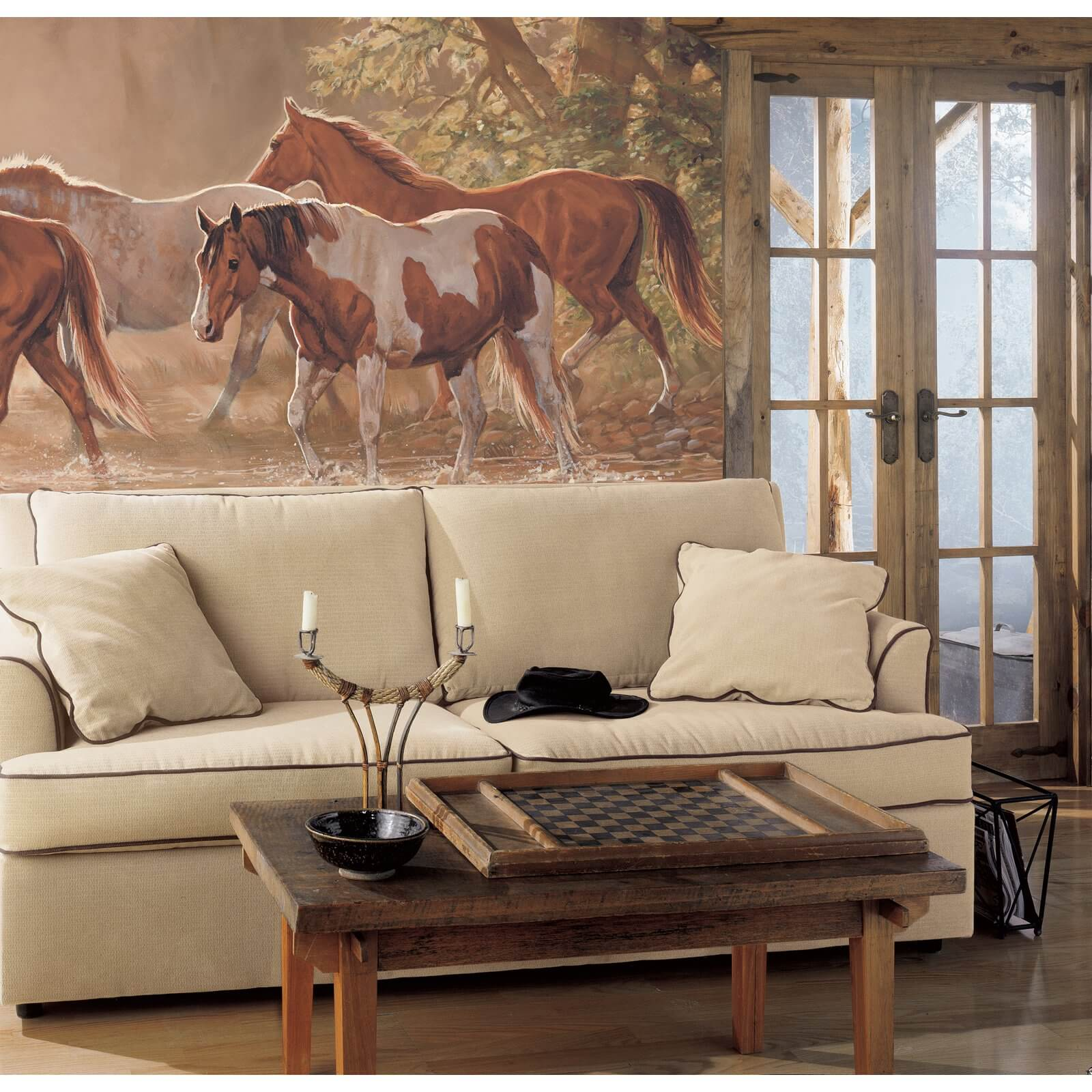 Here we see an amazing piece of art as a backdrop for a western theme. Artwork and murals are a great way to be creative in your space and tie together any theme you may have in your room.