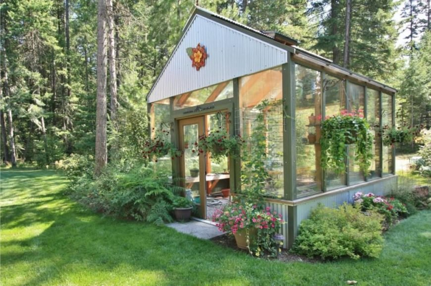 Here is a simple greenhouse with a wooden frame and a bit of personal flair. This greenhouse is the perfect functional escape for a green thumb that just need to escape ti their plants for a little bit.