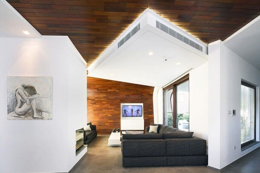 Here is an interesting ceiling with wooden planks. The ceiling curves into the wall giving the room a unique and interesting look