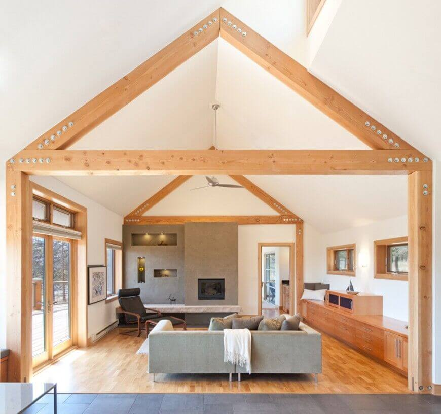 This is an example of a vaulted ceiling with some lovely natural colored exposed beam work. This ceiling along with the clutter free and simple design makes this room feel very open and spacious.