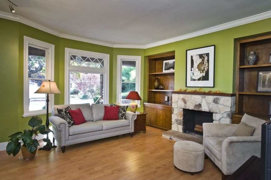 This room has a single, small and round ottoman matching the comfy, welcoming, and roomy chair.