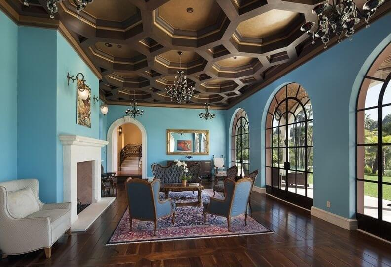 Here is a an elegant coffered ceiling. The sections in this ceiling are octagons, and the recesses are painted gold, giving this coffered ceiling a high end appeal. The numerous chandeliers also provides that elegance that elevates the room with plenty of sophistication.