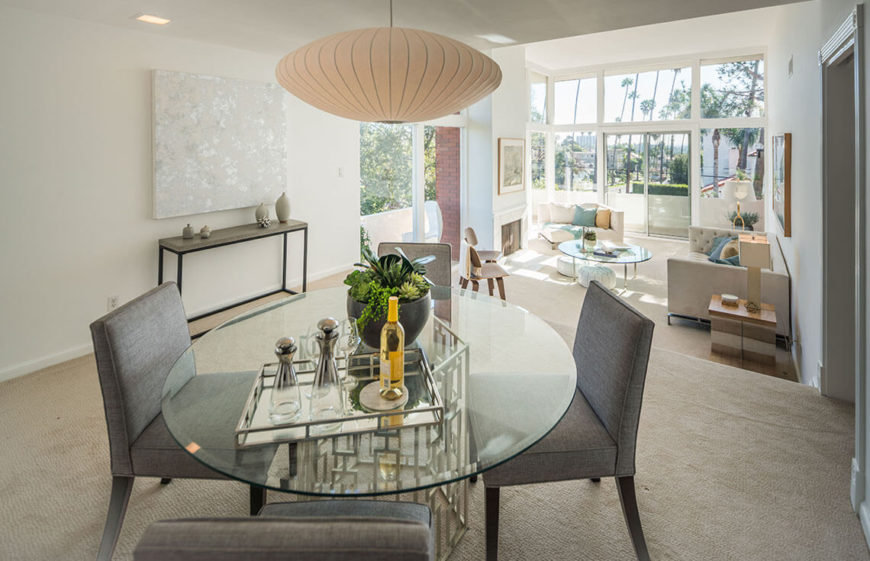 Elegant contemporary dining room with a glass-top table.