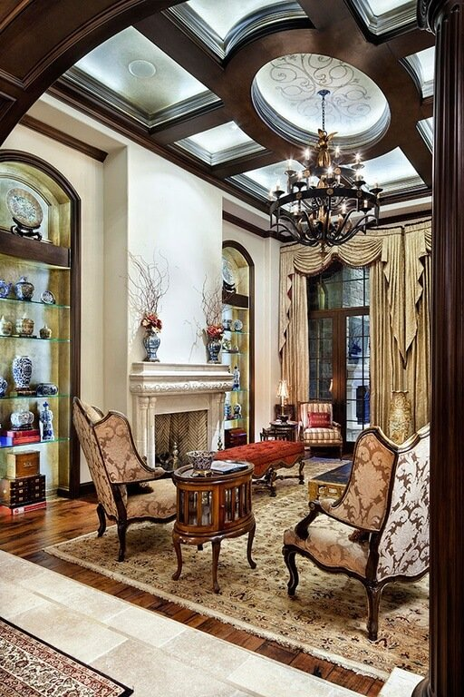 Using lighting to accentuate a coffered ceiling is a great idea. It draws interest to the design and provides soft reflected light. Also, not all of the sections in the coffered ceiling need to be uniform in size or even shape. In this cofferd ceiling there is a circular center with more rectangular sections surrounding it.