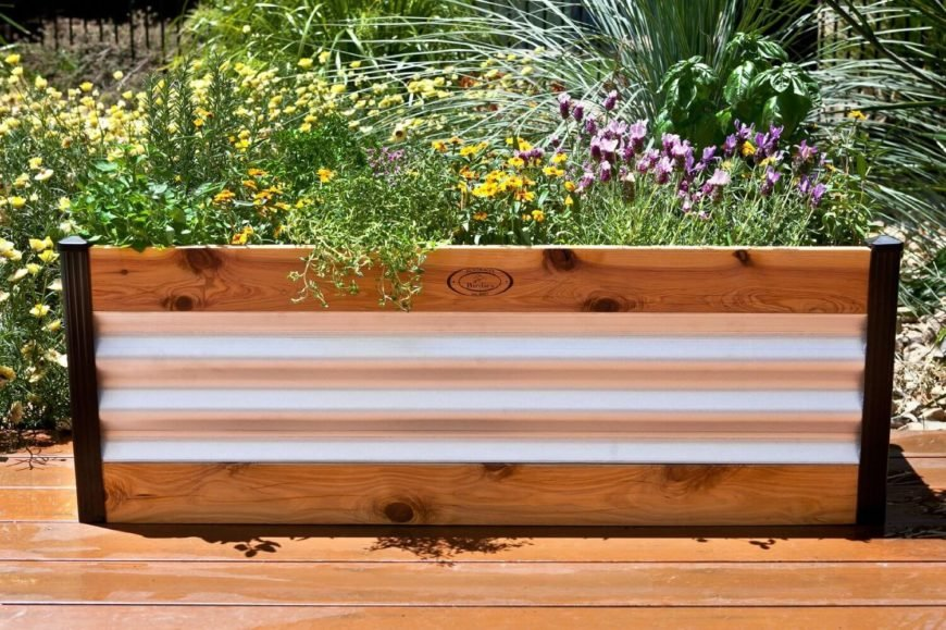 This raised garden bed is made from two materials. The metal provides and interesting and updated design aspect. This does not have the rustic charm of an entirely wooden garden bed, but does have a clean and finished appeal.