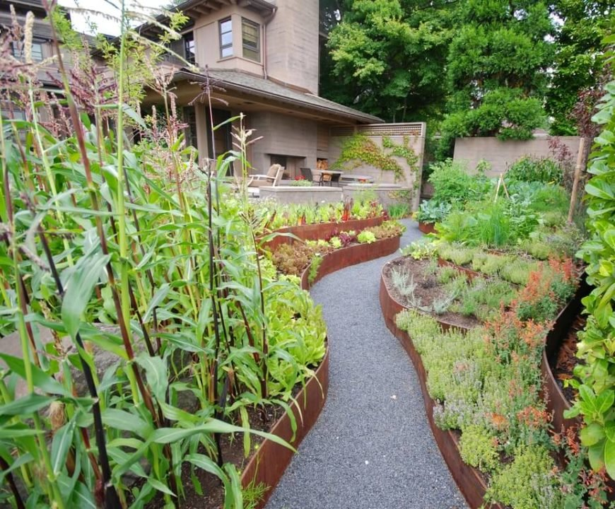 Metal sheeting can be used to shape interesting and unique garden beds. With the right framework, you can manage metal into almost any shape you can imagine.