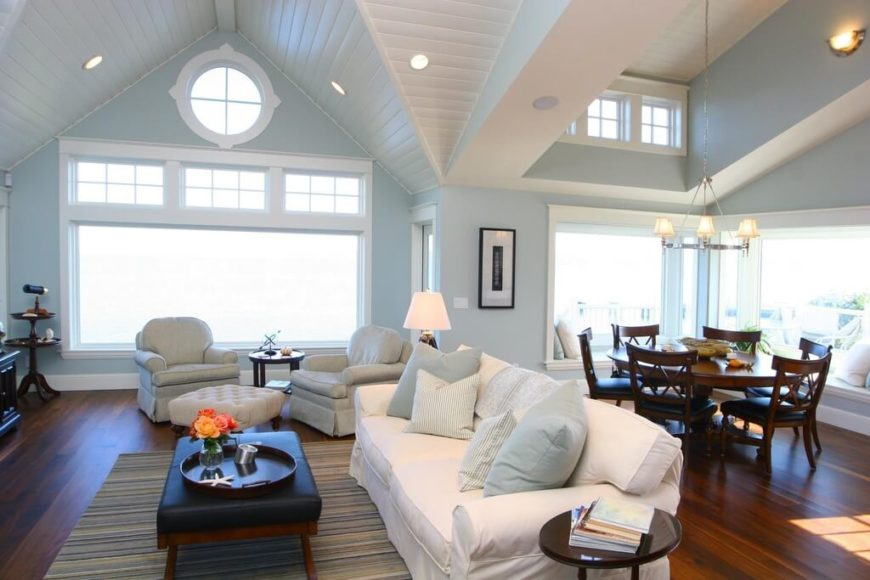 Here we see a modern and elegant vaulted ceiling, in a bright and simple living room area. The white vaulted ceiling helps reflect the natural white lights back down into the room providing the room with a ample ambient light.