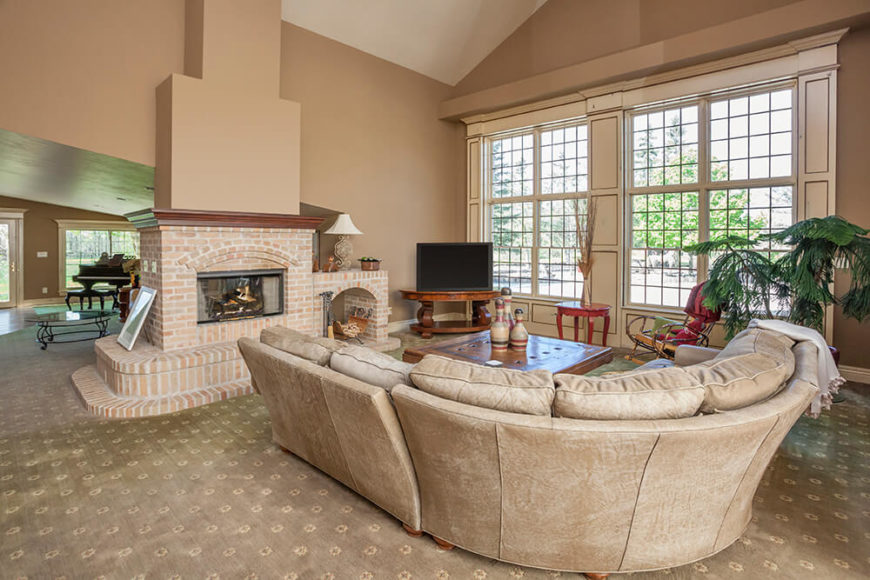 Vaulted ceilings don't have to have a vintage look, or hearken back to the cathedral style ceilings that they are inspired. A vaulted ceiling can be very simple, modern and fit nearly any style. They may cut down on the cozy factor, but they add a greater sense of space, so your living room does not ever feel compact of claustrophobic.