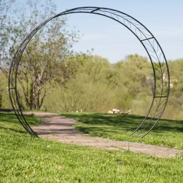A unique arbor in a circular design with a foliage motif as the lattice. These would look fantastic as the beginning of a green tunnel.