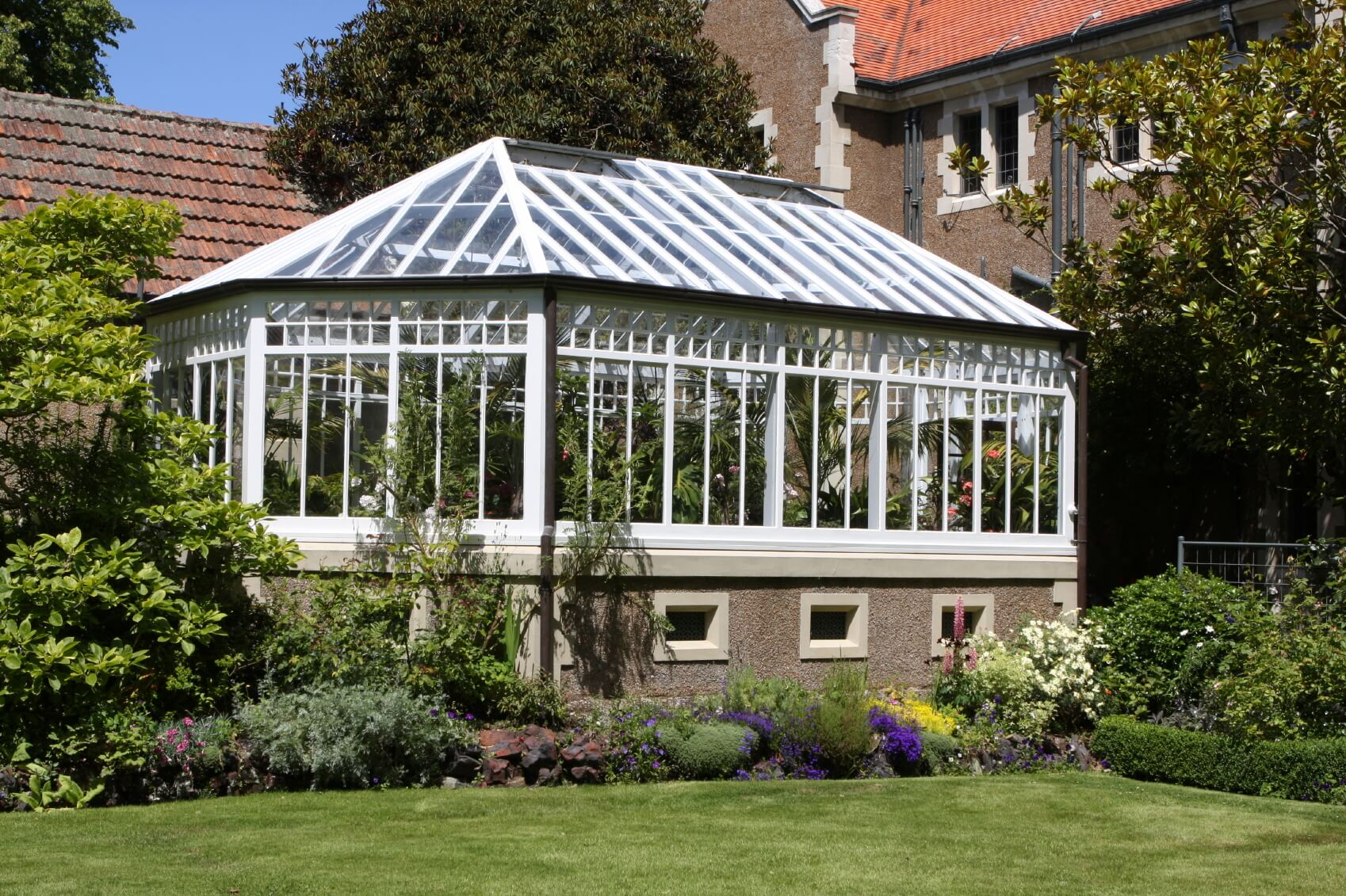 This greenhouse has a sturdy foundation, strong construction, and durable glass glazing. This greenhouse was built to last the ages, and keep the plants going for as long as possible.