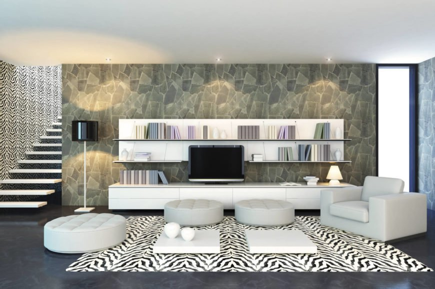 Floating shelves provide shelf space without breaking the clean and minimal design. In this living room we see that the floating shelves have a bright white backdrop that highlights the space.