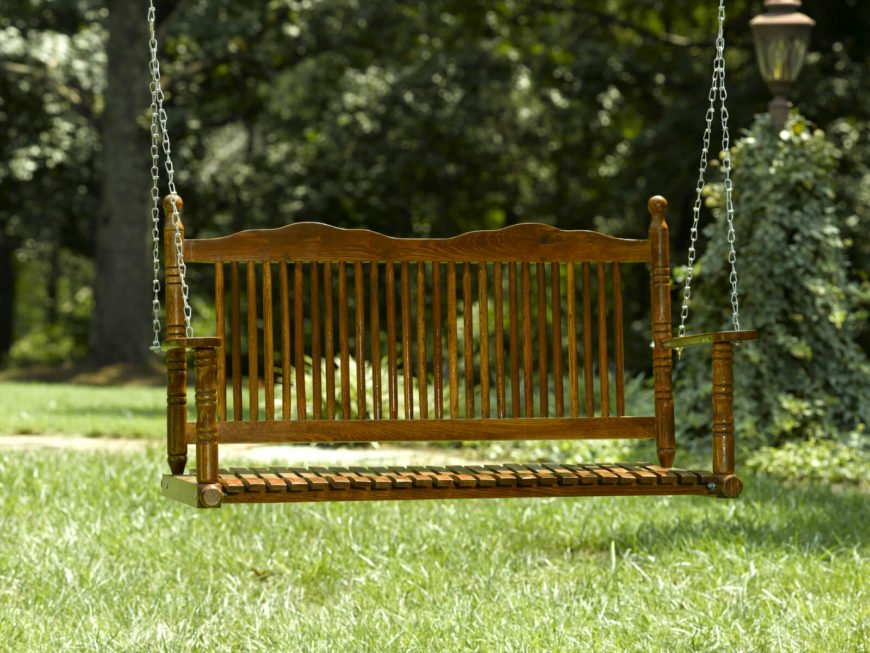 Here is a classic bench seat swing with a finely crafted wood design. Chains are ideal to hang a swing like this, as they are strong and very durable.