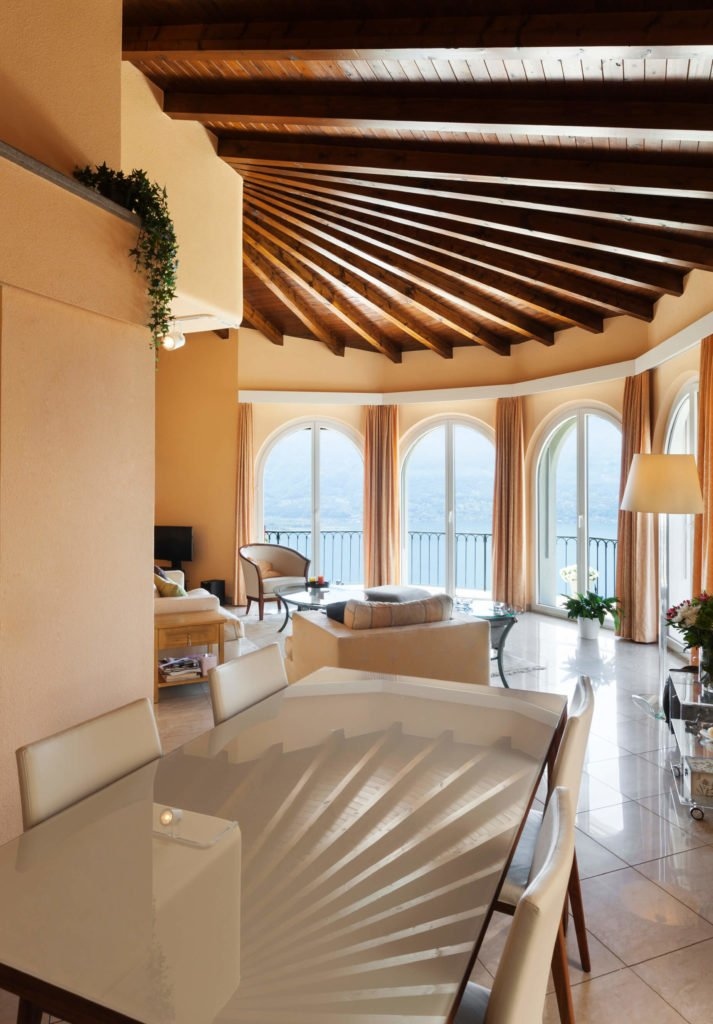 This ceiling as an interesting curved exposed beam design. The room seems much larger with the height of these ceilings, and the exposed wood is finished and treated, which gives the room that extra bit of rich natural wood tones.