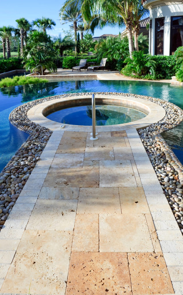 Here we see a luxury hot tub in the center of a lovely pool. If you want to take a relaxing afternoon soak and your friends would rather swim, there is no need to be apart with this layout.