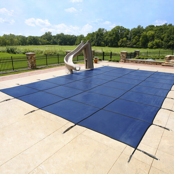 Here is a security pool cover, tethered into the concrete with springs hooks.