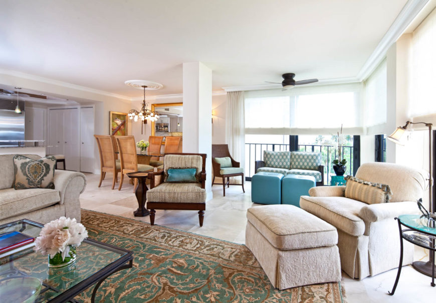 This bright and cool living room has a roomy and comfy chair that is paired with a long and soft ottoman, making this chair very welcoming.