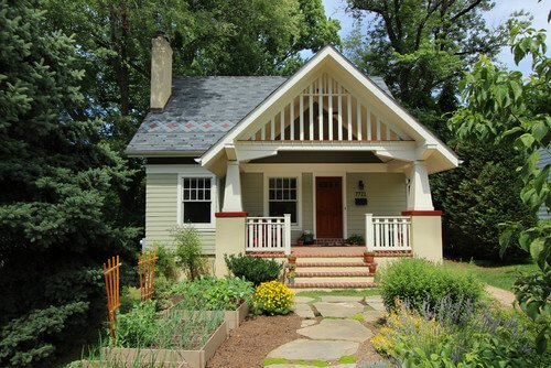 The straight lines of this small craftsman style house emphasizes the care taken in it's construction. Original details like these can really make or break the curb appeal of your home.