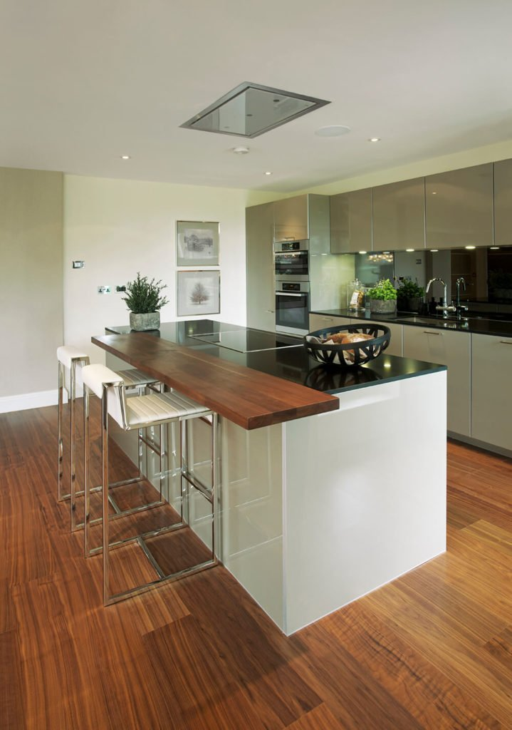 The grain in this laminate flooring is bold, becoming the focal point of this modern kitchen.