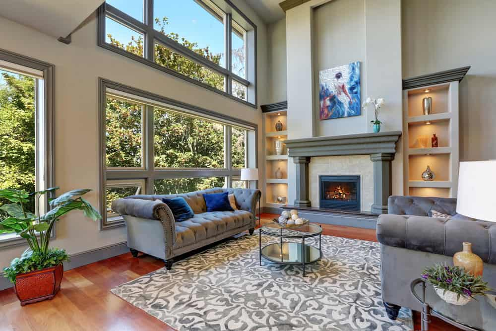 Contemporary living room with are rug, fireplace, tall ceiling and hardwood floor