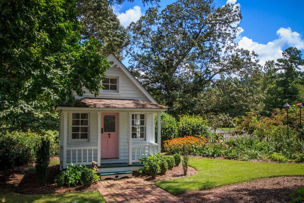 Wow! Incredible white and pink playhouse with immaculate detail. Includes front porch.
