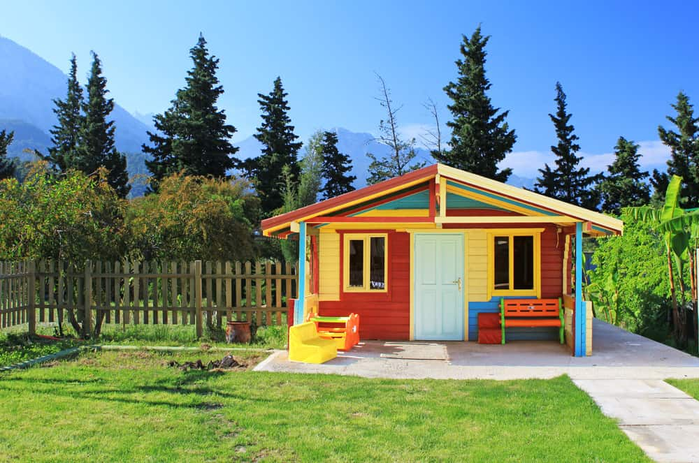 Bright multi-colored playhouse in the backyard.