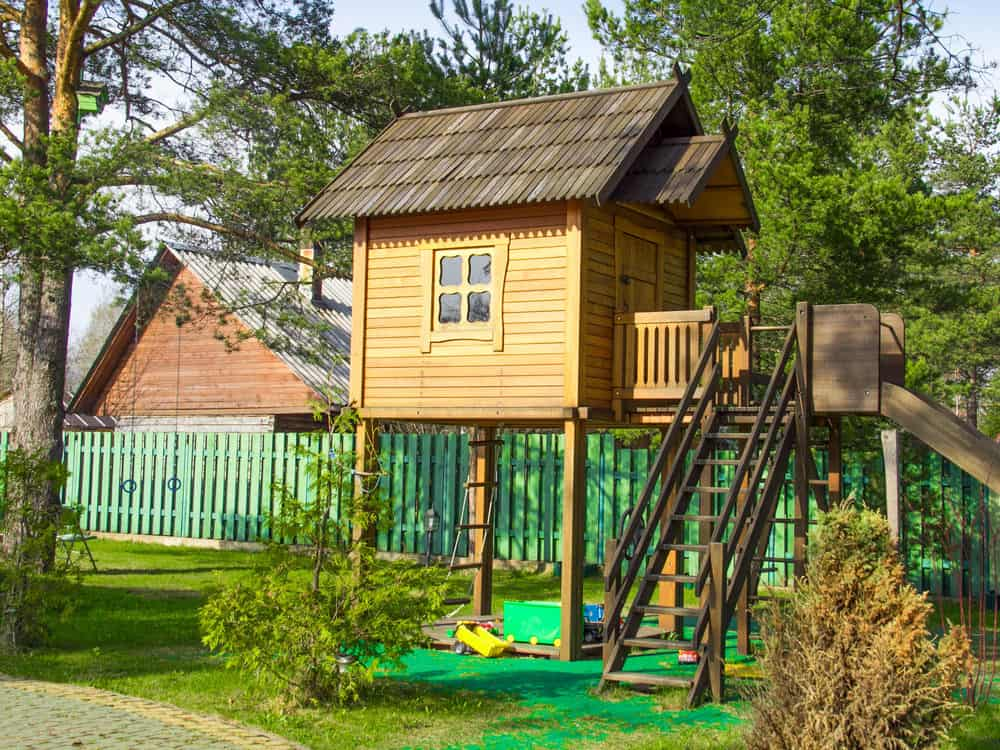 Very high up playhouse with ladder-like staircase.