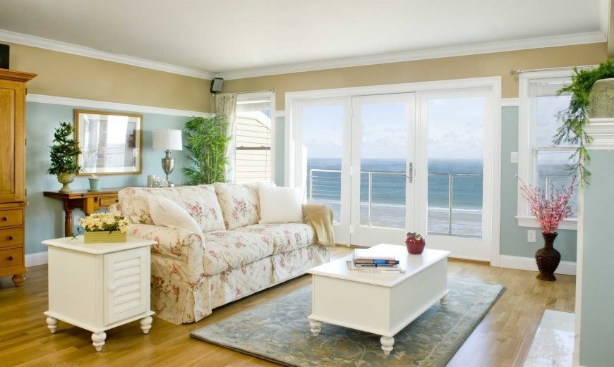 Here is a shabby chic living room with plenty of white painted furnishings, and simple, bright colors. Silver features add to the feel as the color on the sofa cover makes the look complete.