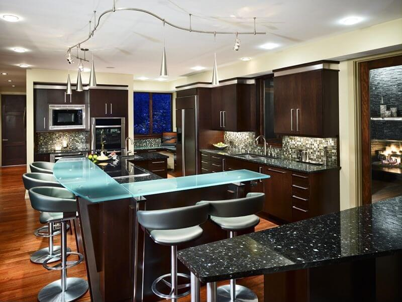 This kitchen features two types of recycled glass countertops, colored and the more traditional black.