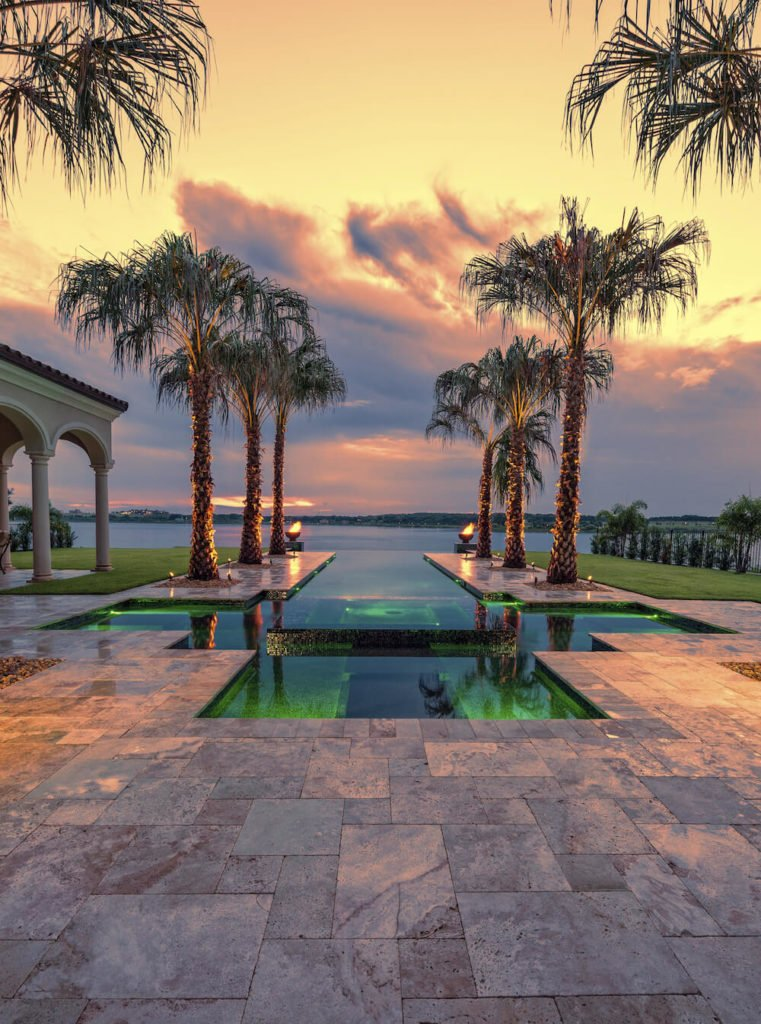 This infinity pool is lined with fantastic palm trees. These trees introduce a sense of motion down the length of the infinity pool and out to the ocean. Using trees like this can be great for drawing the eyeline in a desired direction.