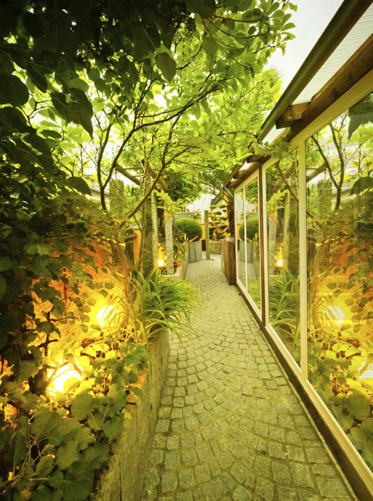 Well lights work great in a garden. When plants grow around the well lights the light shining upward gives your plants a warm glow.