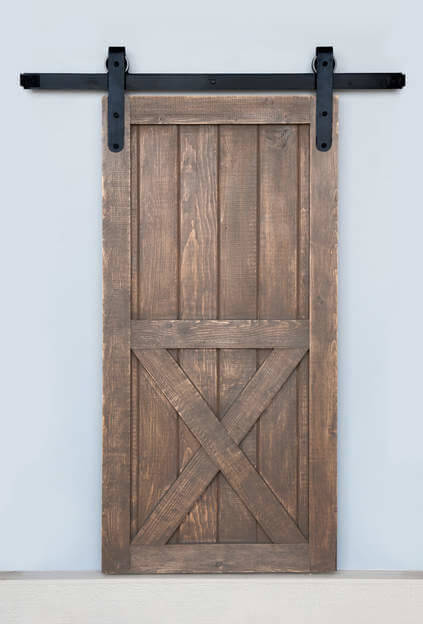 In some cases, it's the construction of the barn door that gives it its charm. This barn door has the classic X shaped supports on the bottom half of the door.