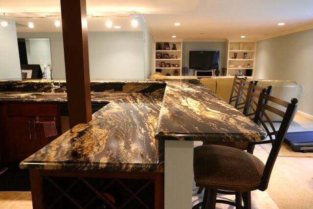 If you're really looking for dramatic, black granite with rich gold veining might be exactly what you need. Pair something this showy with simple cabinets and let it shine.