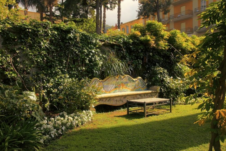 This bench is painted with some art that makes it personal and customized to this area. If your bench is the primary seating in a garden or secluded area you can take steps like this to make the bench a central focus. It becomes unique and special to that area.