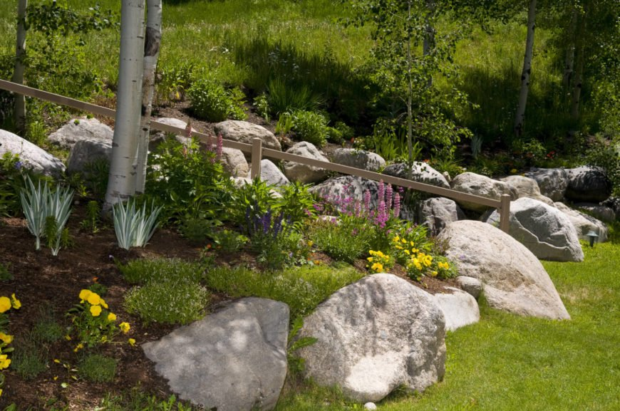 Rock gardens are perfect for lining paths and walkways. Large rocks work to keep people on track and off of areas that you don't want them to travel. They act as decorative obstacles that can keep your plants safe. This is a more natural looking and less obvious barrier than a fence.