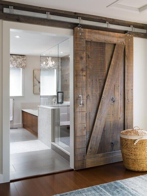 This sliding door can be used to close off the lovely primary bathroom whenever privacy is so desired.