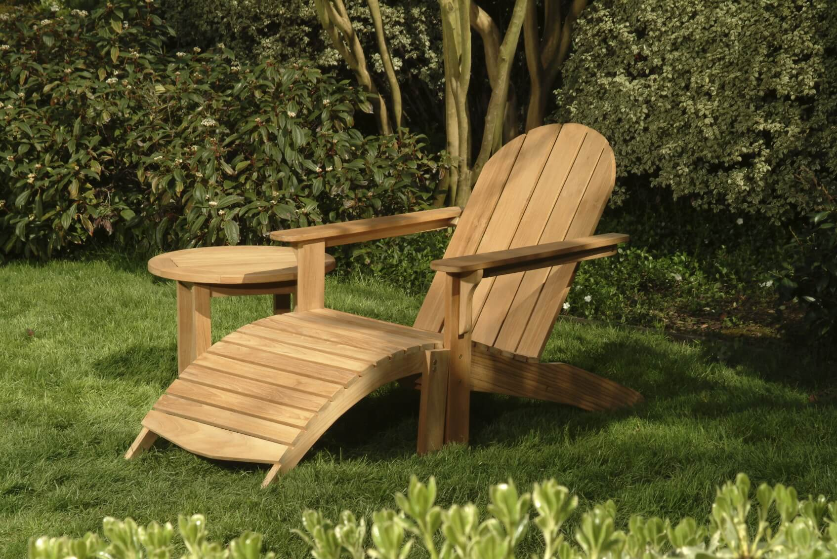 Some adirondack chairs have more of a leg rest than others Here we see one that has a long curved leg rest. In this seat you will be nearly laying down.