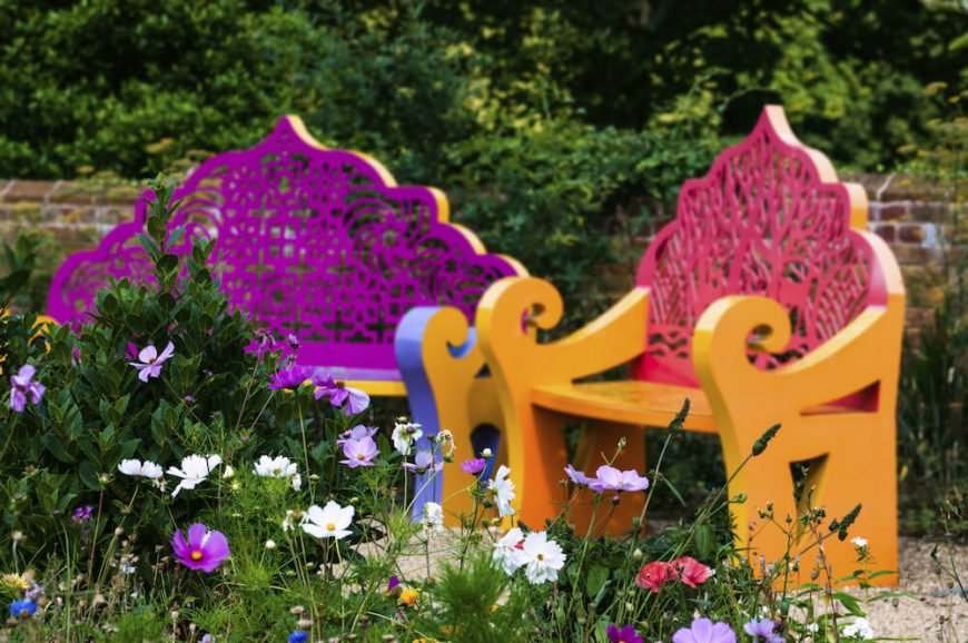 Gardens can have a wide range of vibrant colors that really draw the eye. Why not have benches with the same level of bright and engaging colors? Experiment with patterns and color palettes that you enjoy.