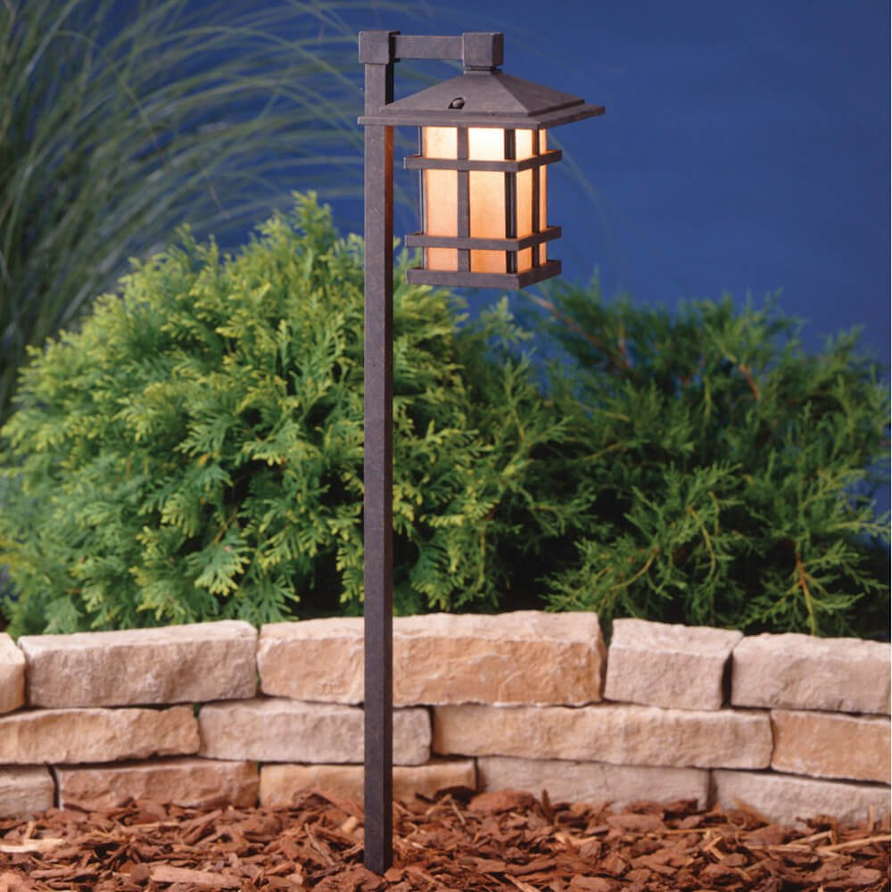 Lanterns are a great way to provide light to a garden. This lantern has a nice iron look that brings an old English charm to your garden.