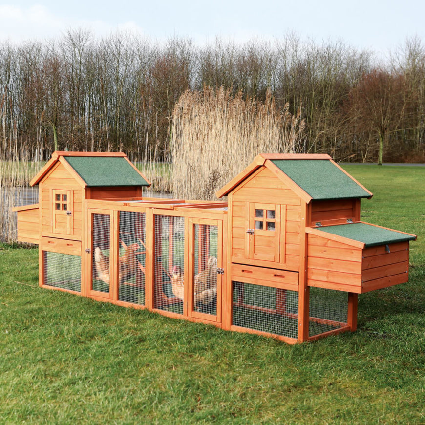 We love the deluxe nature of this chicken coop duplex. With a pair of robust shelters joined by an extended exercise space and plenty of wire fencing, it's a great solution for multiple chickens in a relatively small yard.