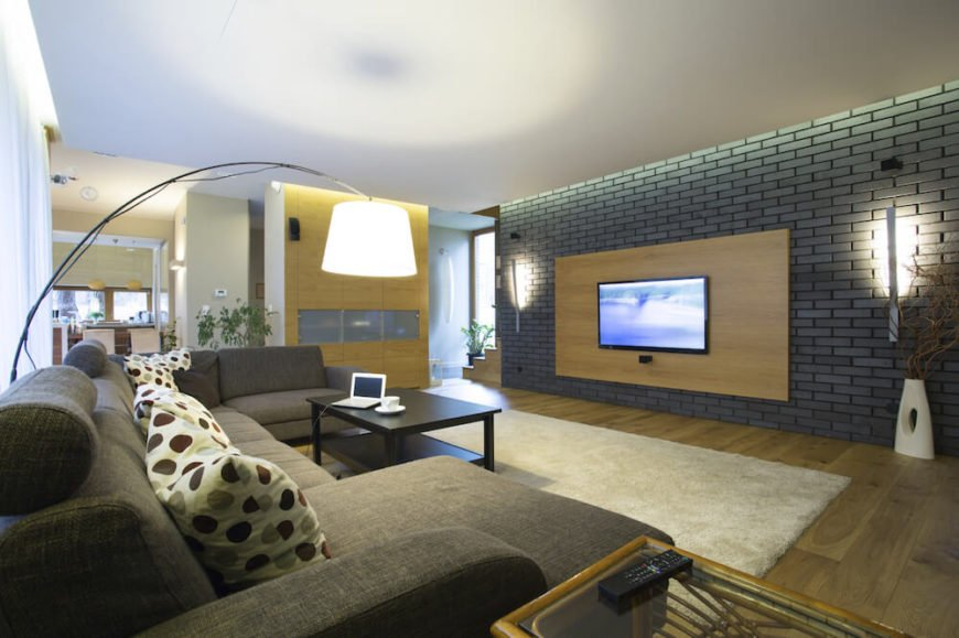 Adding a colorful accent wall to a living room draws the eye towards that wall, and in this case, to the television.