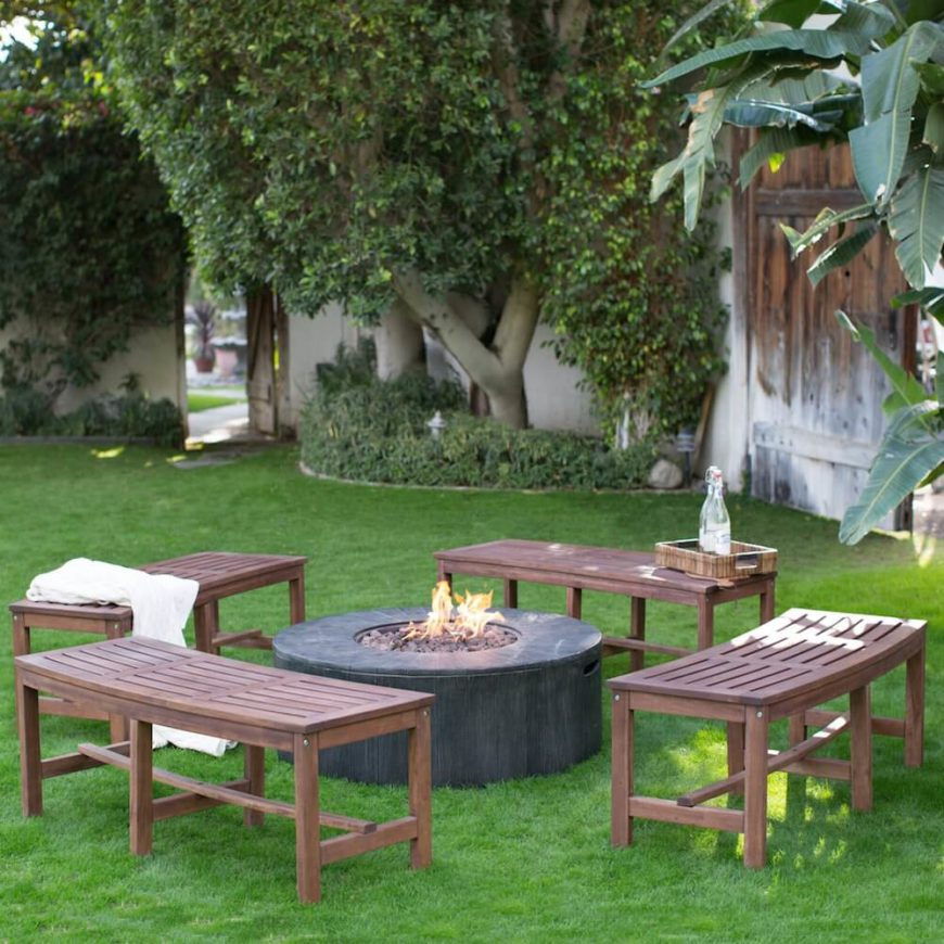 These four slightly curved benches are all situated around a fire pit. This makes for a great gathering spot with wonderful seating. Everyone is near the fire and still on matching seating. A perfect place for a night around the fire.