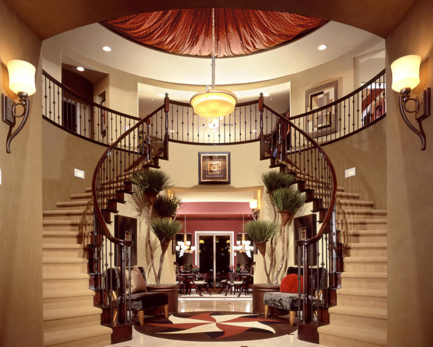 Incredible foyer with dual staircases for an imposing first impression.